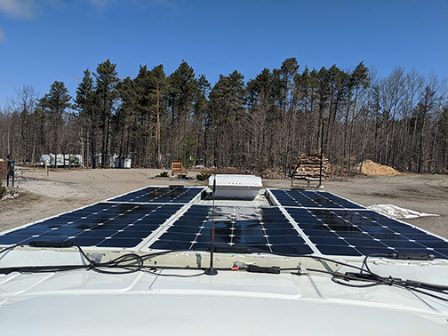 what customer say about Microgreen solar panels installed on the roof of his cabin