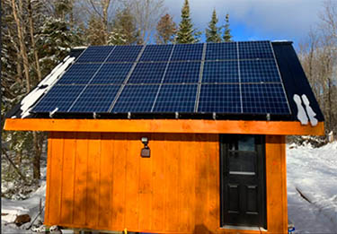 What a customer say about Microgreen solar panels and off-grid system design for his cabin.