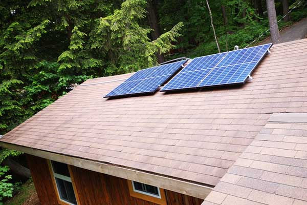 installation of Microgreen solar panels on cottage roof
